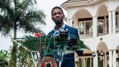 Ugandan opposition leader Bobi Wine says he is under military siege