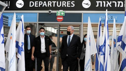 Israel bans international flights to curb virus spread