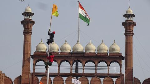 Angry farmers storm India's Red Fort in massive tractor rally
