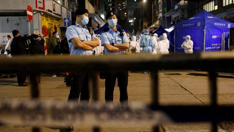 Hong Kong turns to ambush lockdowns to fight virus