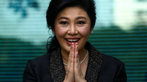 Thailand's ex-PM Shinawatra flees abroad - sources