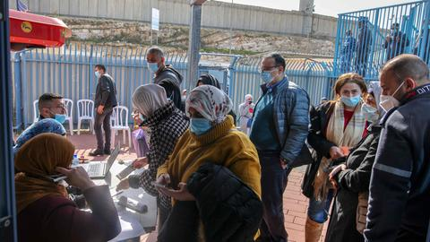 Palestinians unprotected as Israel vaccinates half of its population