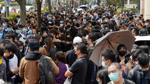 Protesting crowds gather outside Hong Kong court after dissidents charged