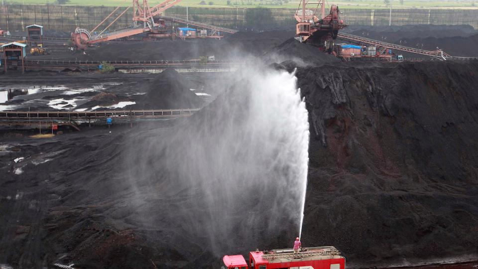 Water is sprayed over coal to be used to generate electricity at a coal-fired power plant of Essar Power in Salaya village in the western state of Gujarat, India, on October 4, 2016.