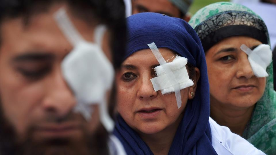Kashmiri doctors and paramedics, their eyes covered by patches, protest at a hospital in India-held Kashmirs Srinagara area in hopes of evoking the plight of victims of pellet guns fired by Indian security forces to disperse crowds.