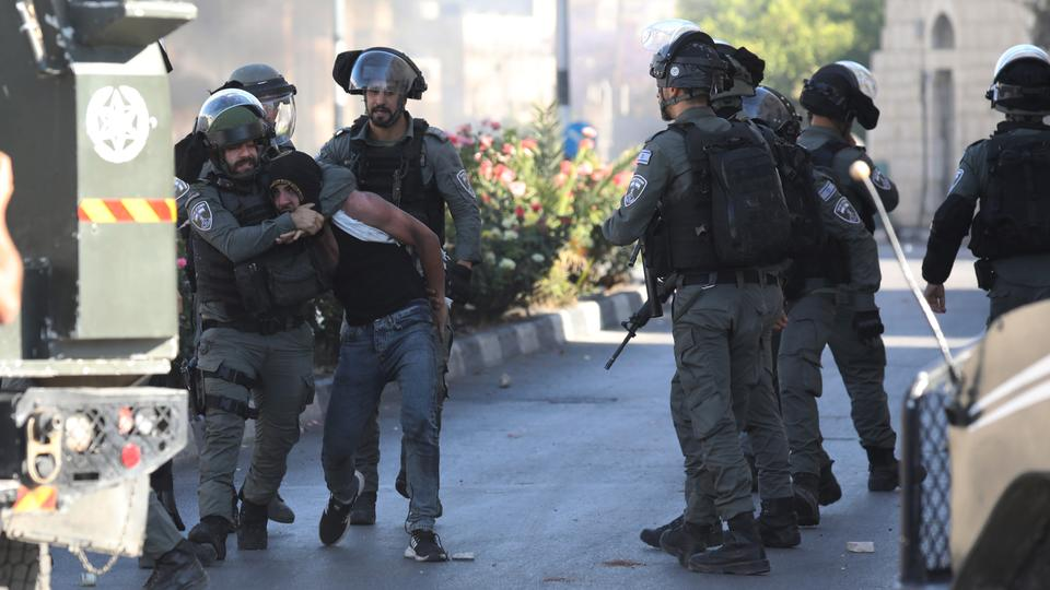 Israeli forces detain a Palestinian during a demonstration to protest against Israeli attacks on Gaza and violations in East Jerusalem, on May 18, 2021, in occupied West Bank.