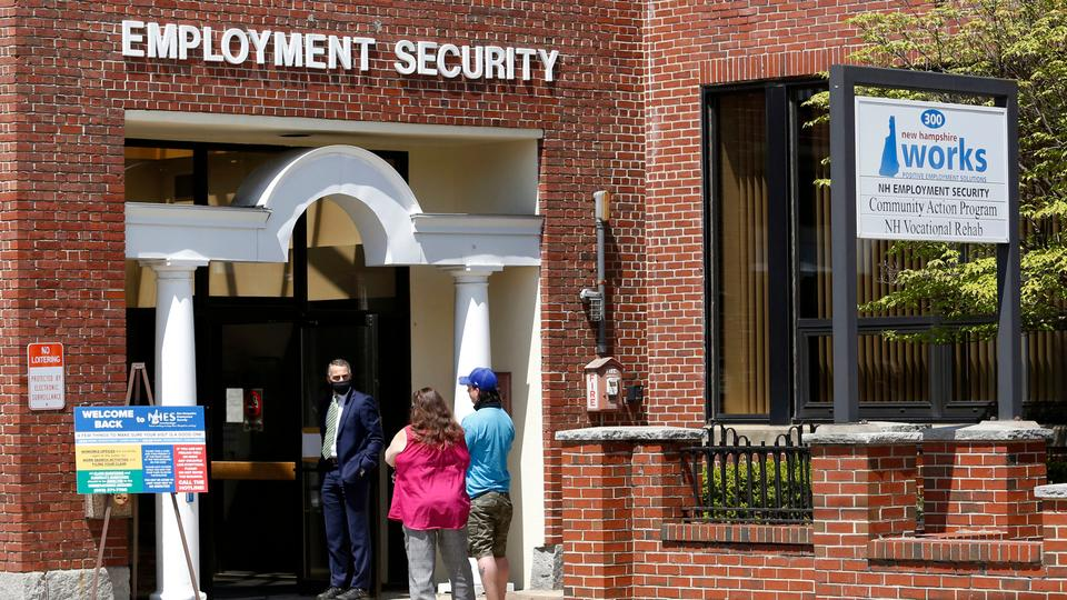 Job seekers wait outside the New Hampshire Works employment security job centre in Manchester, US on May 10, 2021.