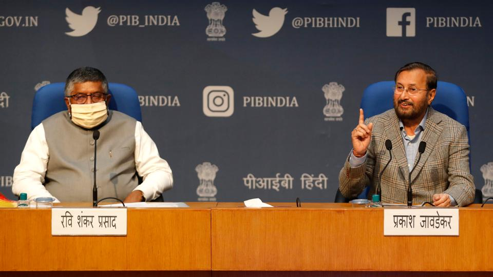 In this Thursday, February 25, 2021, file photo, India's Information Technology Minister Ravi Shankar Prasad, left, and Information and Broadcasting Minister Prakash Javadekar address a press conference announcing new regulations for social media companies and digital streaming websites in New Delhi, India.