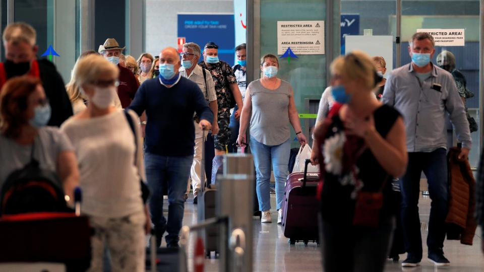 Tourists wearing face masks arrive from Poland to Malaga-Costa del Sol airport, in Malaga, Spain, May 24, 2021.