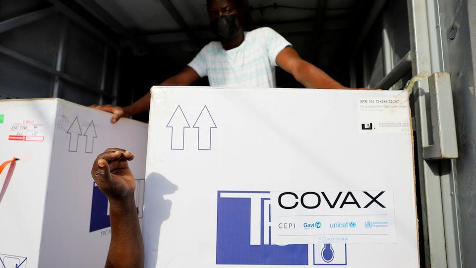 Boxes of AstraZeneca vaccines, redeployed from the Democratic Republic of Congo, arrive at a cold storage facility in Accra, Ghana on May 7, 2021.