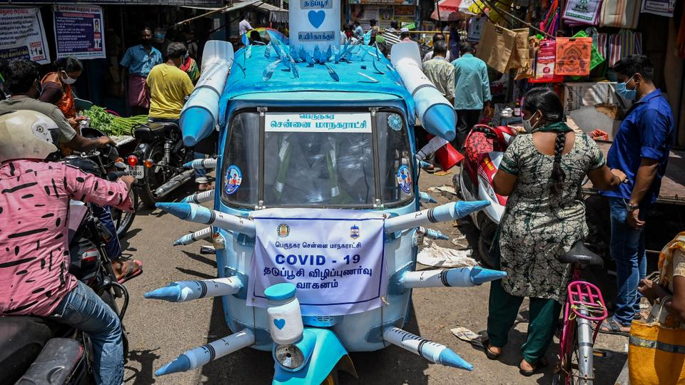 A municipal worker drives an auto-rickshaw decorated with mock syringes through the streets to boost awareness on the importance of Covid-19 vaccination in Chennai on July 3, 2021.