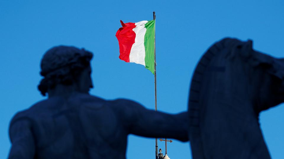 FILE: An Italian flag flies over the Quirinale Palace in Rome, Italy, January 26, 2021.