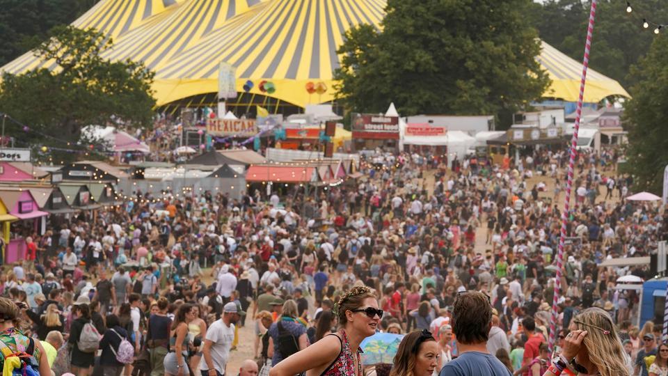 Festival goers attend the Latitude festival in Henham Park, in Southwold, UK, on July 23, 2021.