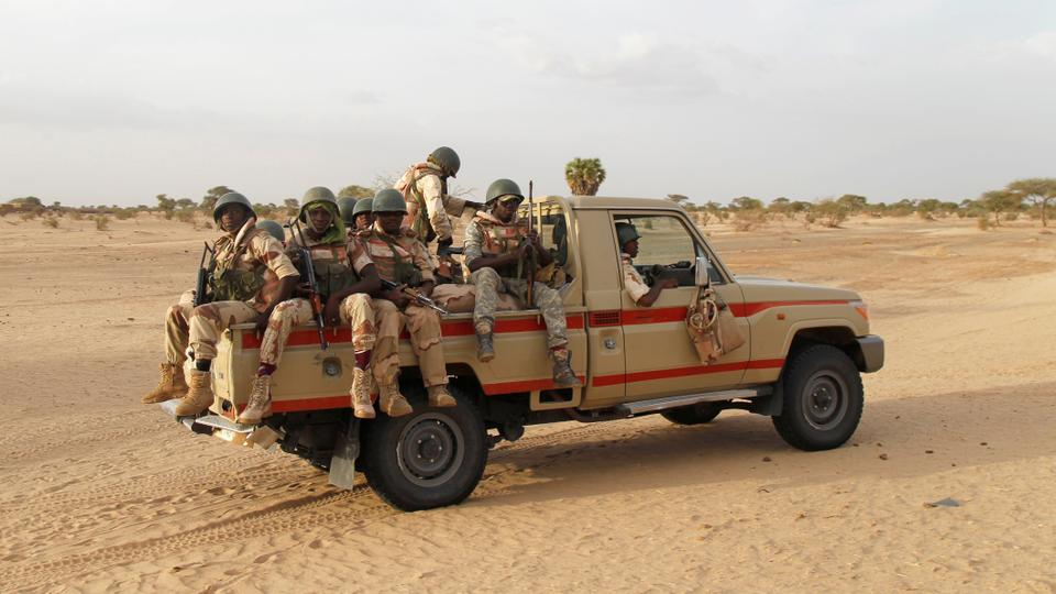 FILE PHOTO: Nigerien soldiers patrol at the border with neighbouring Nigeria near the town of Diffa, Niger, on June 21, 2016.