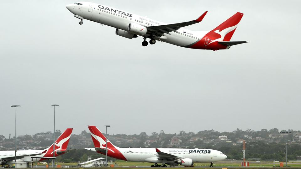 A Qantas plane taking off from the Sydney International airport.