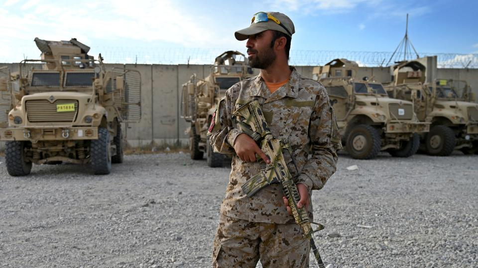 An Afghan policeman stands guard inside the Bagram US air base after all US and NATO troops left, some 70 km north of Kabul.