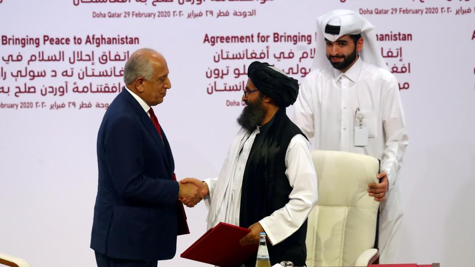 Mullah Abdul Ghani Baradar, Taliban co-founder, and Zalmay Khalilzad, US special envoy on Afghanistan, shake hands after signing a deal in Doha, Qatar on February 29, 2020.