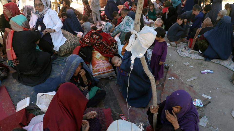 Internally displaced Afghan women from northern provinces, who fled their home due to fighting between the Taliban and Afghan security personnel, receive medical care in a public park in Kabul