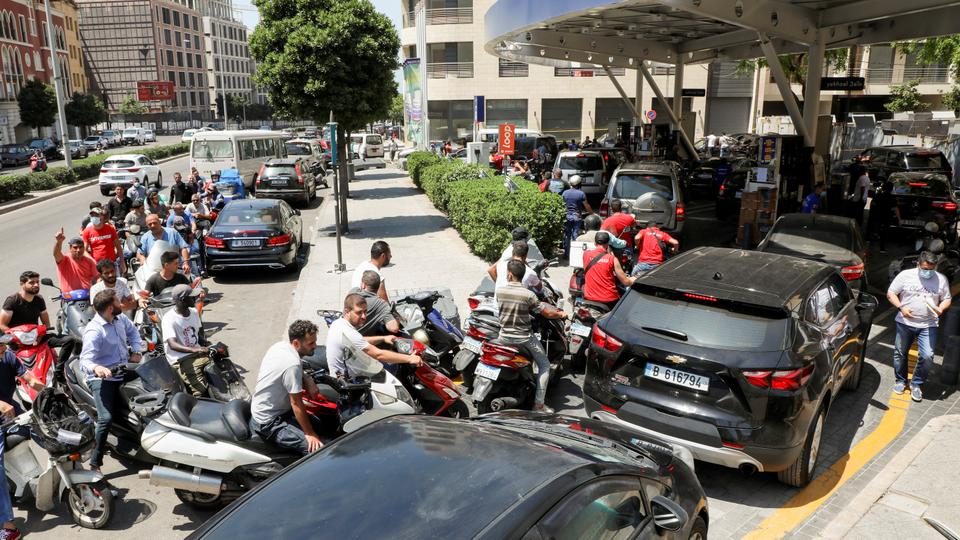 Motorbike and car drivers wait to get fuel at a gas station in Beirut, Lebanon June 29, 2021.