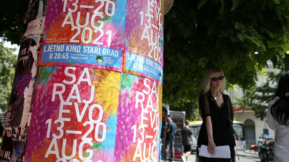 Women walk past the Sarajevo Film Festival posters in Sarajevo in Sarajevo, Bosnia and Herzegovina, August 9, 2021