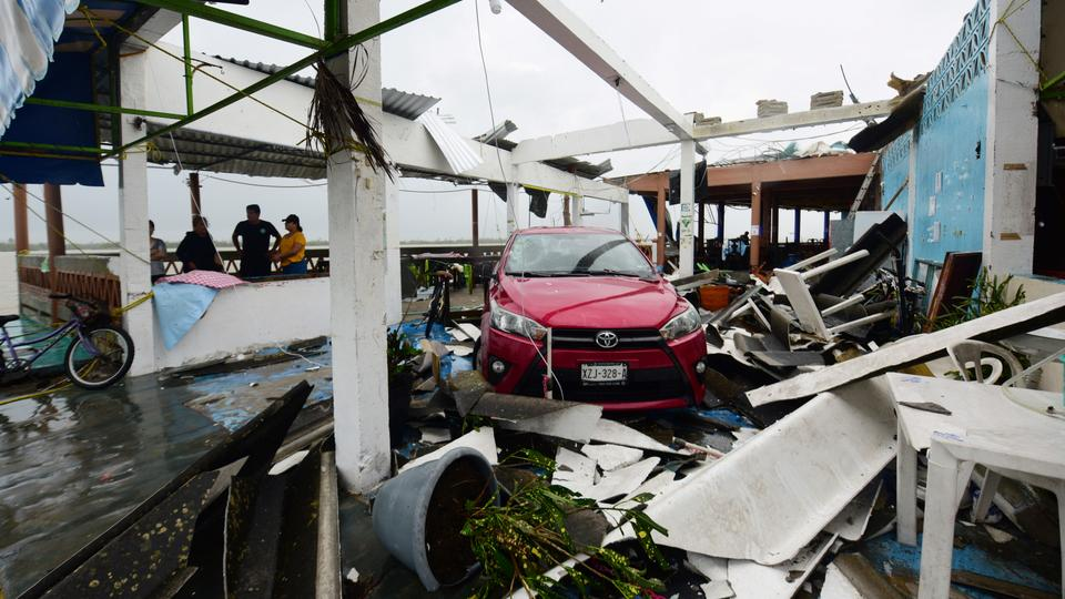 A car stands parked amidst the debris of restaurants that were destroyed after Hurricane Grace slammed into the coast with torrential rains, in Costa Esmeralda, near Tecolutla, Mexico August 21, 2021.