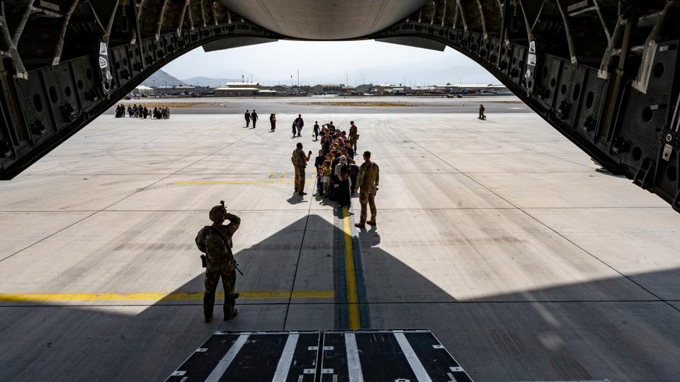 A US Air Force security forces raven maintains a security cordon outside a US Air Force C-17 Globemaster III aircraft in support of Operation Allies Refuge at Hamid Karzai International Airport in Kabul, Afghanistan, Friday, on August 20, 2021.