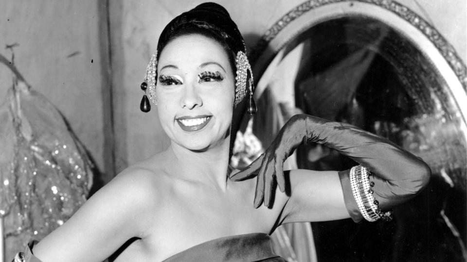 In this file photo dated March 6, 1961, singer Josephine Baker poses in her dressing room at the Strand Theater in New York City, USA.