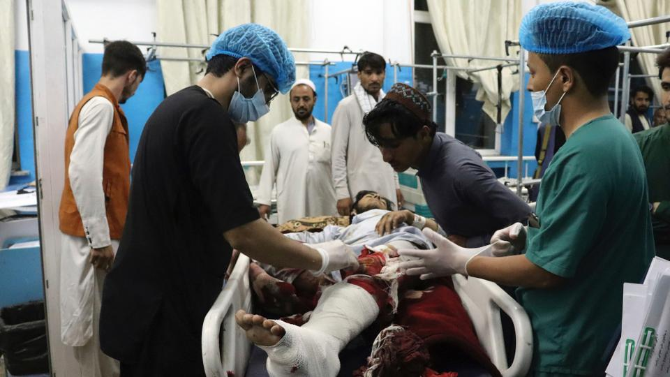 A victim receives medical assistance in a hospital after he was wounded in the deadly attacks outside the airport in Kabul, Afghanistan, August 26, 2021.