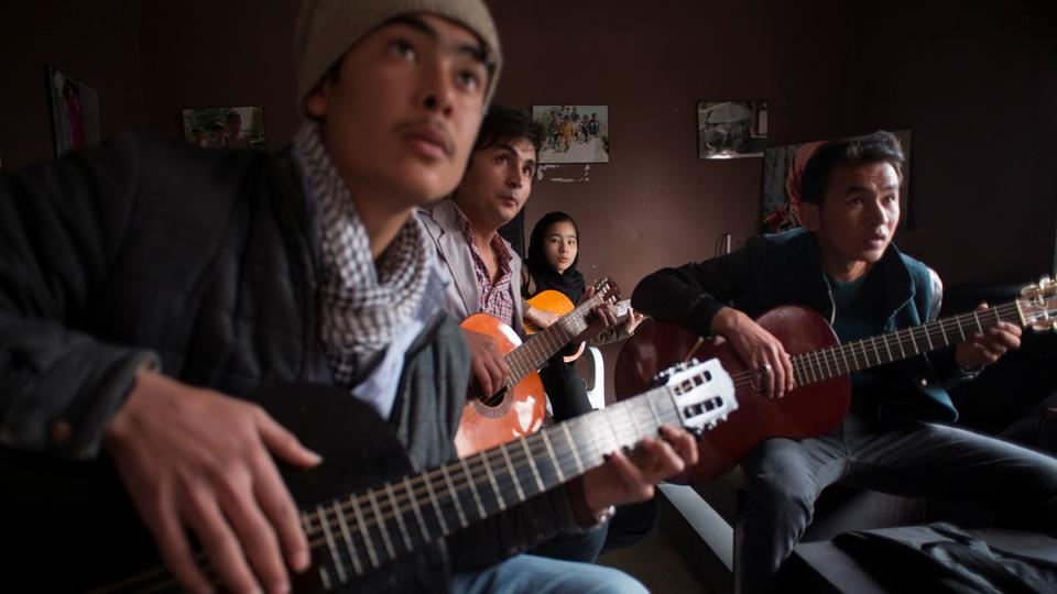 FILE PHOTO: Afghan music students participate in a music training session at a cultural and educational centre in Kabul March 7, 2014.