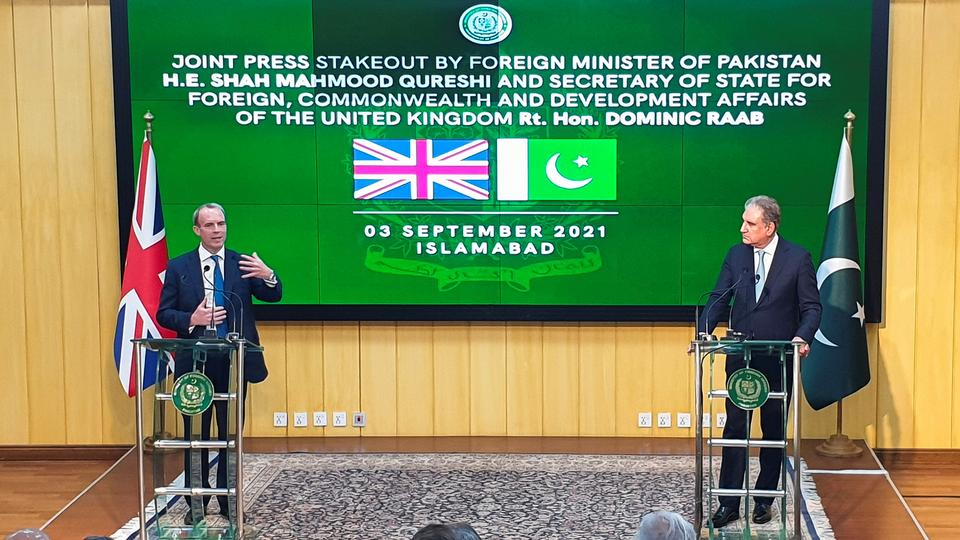 Britain's Foreign Secretary Dominic Raab speaks next to Pakistan's Foreign Minister Shah Mahmood Qureshi during a joint news conference in Islamabad, Pakistan September 3, 2021.