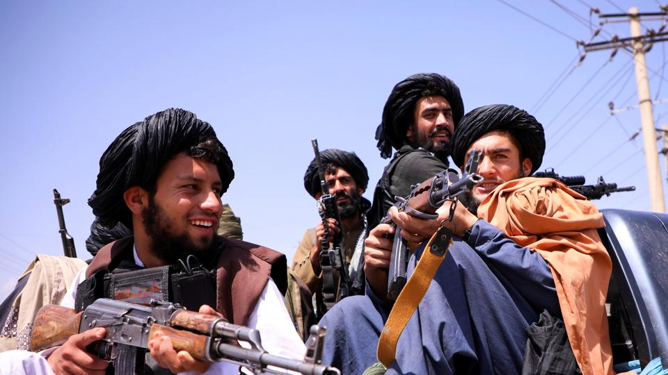 Taliban forces patrol in front of Hamid Karzai International Airport in Kabul, Afghanistan, on. September 2, 2021.