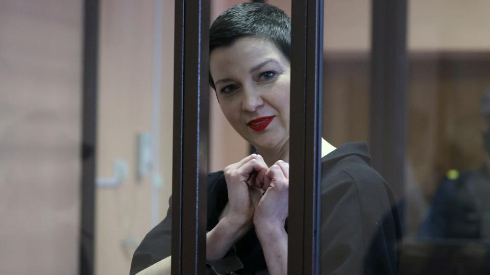 Belarusian opposition politician Maria Kolesnikova, charged with extremism and trying to seize power illegally, gestures inside a defendants' cage as she attends a court hearing in Minsk, Belarus on September 6, 2021.