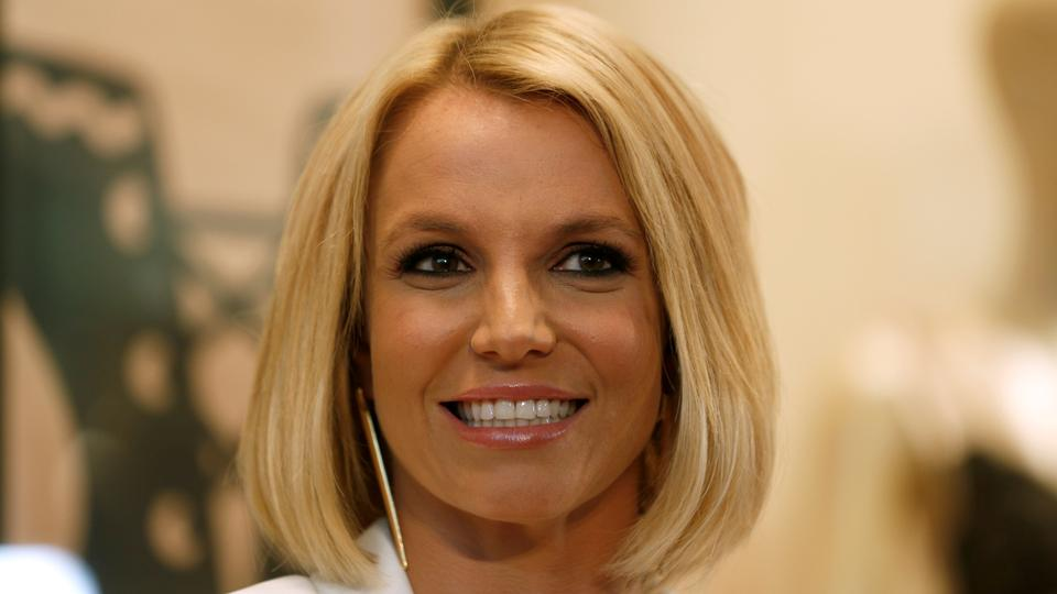 In this September 25, 2014 file photo, Britney Spears smiles during the launch of her lingerie collection at a shopping mall in Oberhausen, Germany.