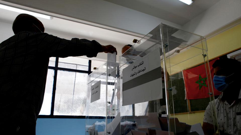 A man casts his ballot inside a polling station in Casablanca, Morocco on September 8, 2021.
