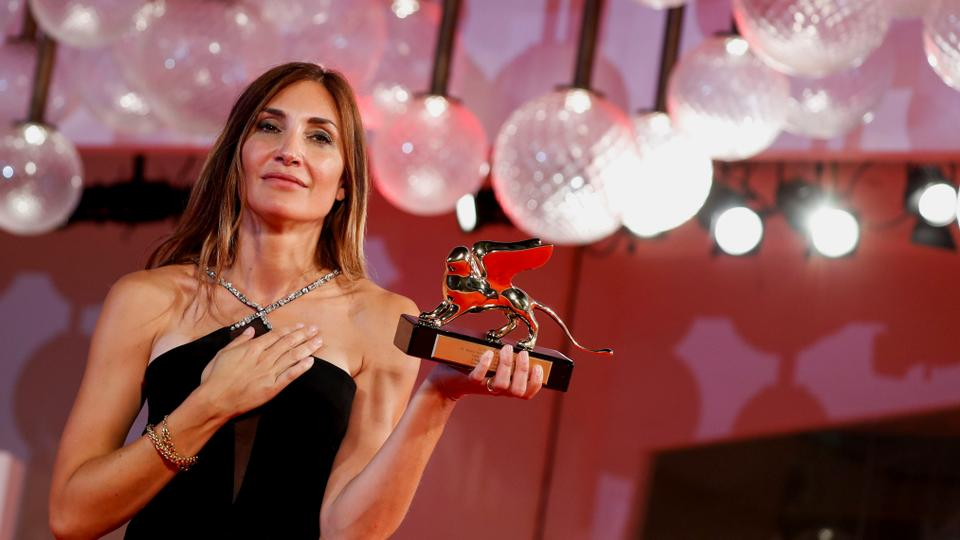 Director Audrey Diwan poses with her Golden Lion award for Best Film at the The 78th Venice Film Festival.