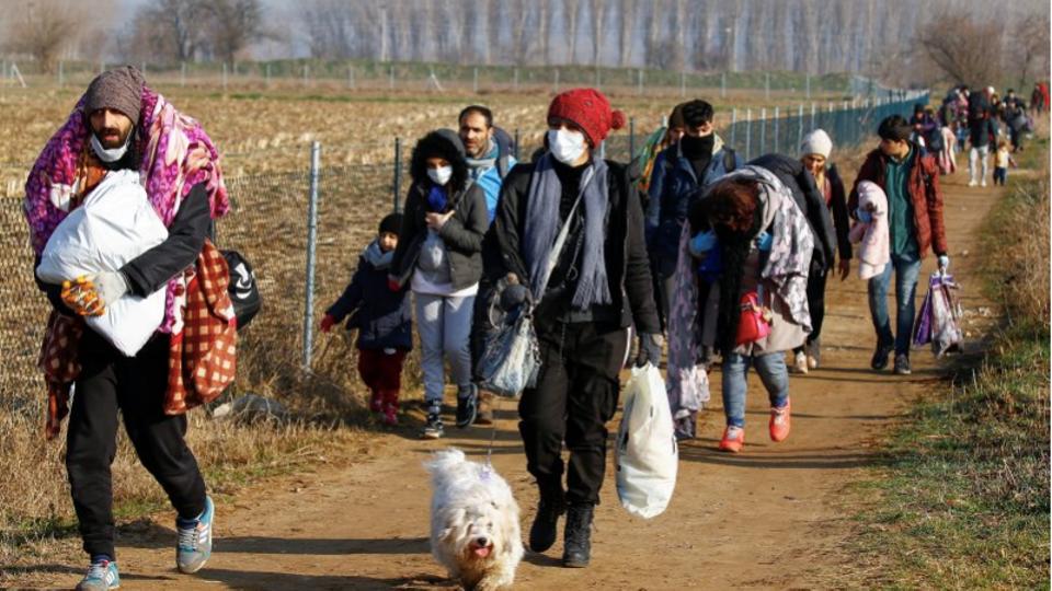 FILE PHOTO: Migrants walk toward Turkey's Pazarkule border crossing with Greece's Kastanies, in Edirne, Turkey, on March 1, 2020.