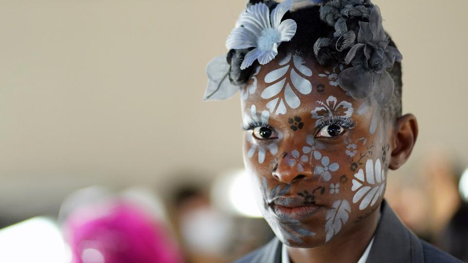 A model appears backstage in preparation for the Thom Browne fashion show during New York Fashion Week at The Shed, on September 11, 2021, in New York