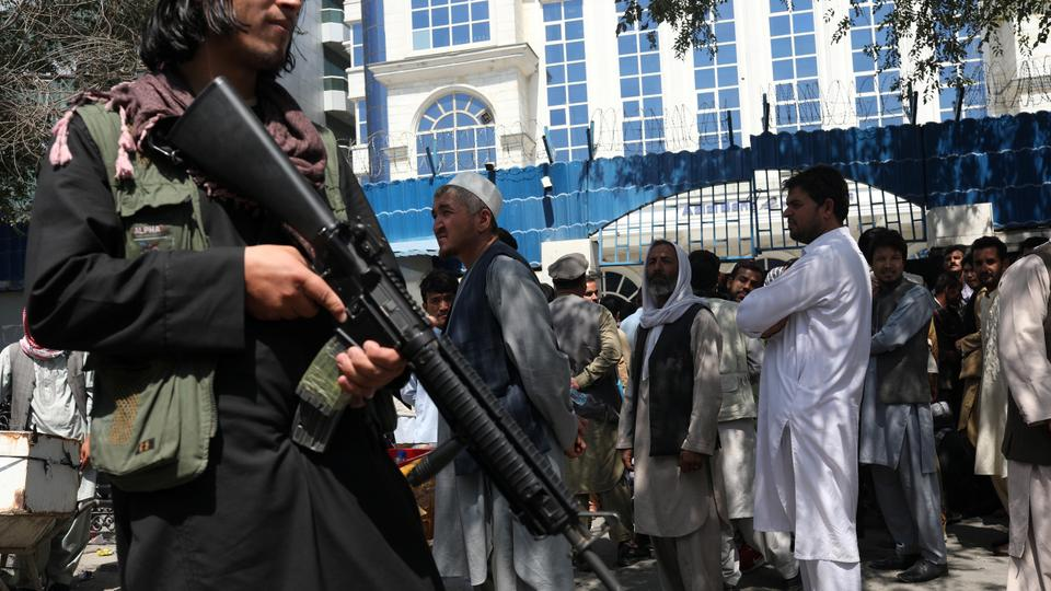 A Taliban security member holding a rifle ensures order in front of Azizi Bank in Kabul, Afghanistan, on September 4, 2021.