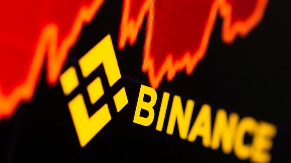 Binance logo and stock graph are displayed in this illustration taken, on June 28, 2021.