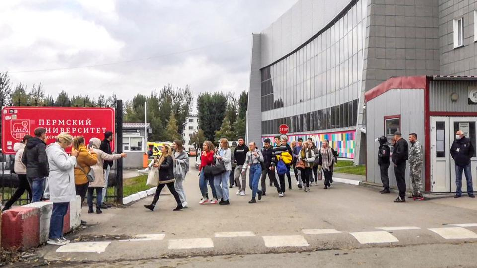 Students evacuate a building of the Perm university campus in Perm, September 20, 2021.