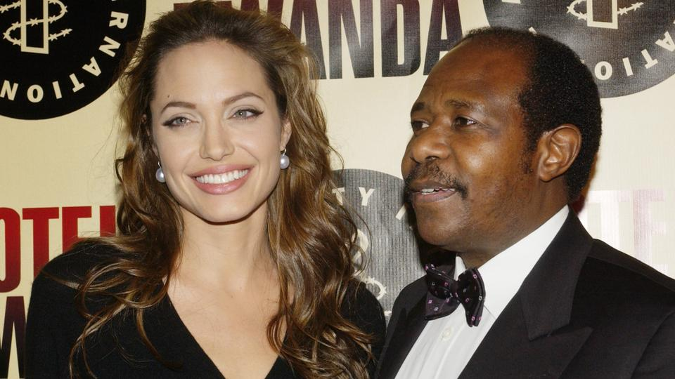 In this December 2, 2004 file photo, actress Angelina Jolie poses with Paul Rusesabagina (R) during the premiere of the film at the Academy of Motion Picture Arts & Sciences in Beverly Hills.