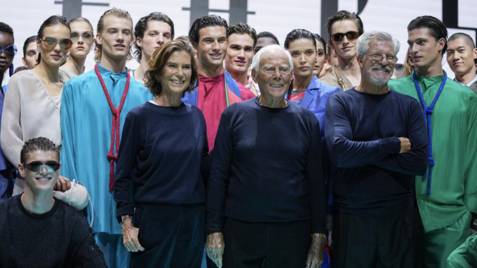 Silvana Armani from centre left, Giorgio Armani and Leo Dell'Orco stand with models after the Emporio Armani Spring Summer 2022 collection during Milan Fashion Week, in Milan, Italy, September 23, 2021.
