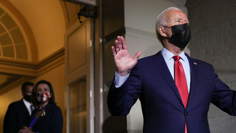 US President Joe Biden talks to reporters as Speaker of the House Nancy Pelosi listens as they depart after the president and the speaker met with Democratic lawmakers at the US Capitol to promote his bipartisan infrastructure bill, Washington, US, October 1, 2021.