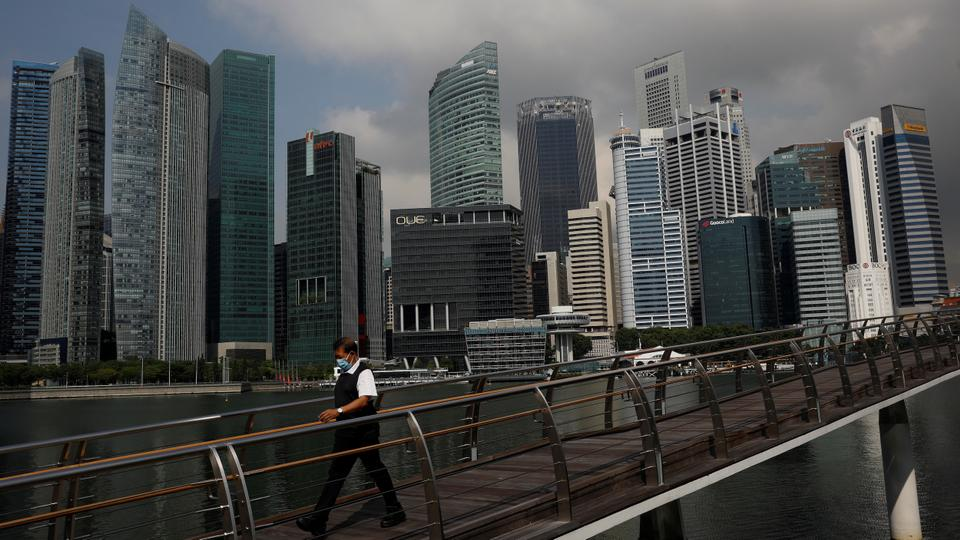 A man passes the city skyline during the pandemic in Singapore on September 29, 2021.