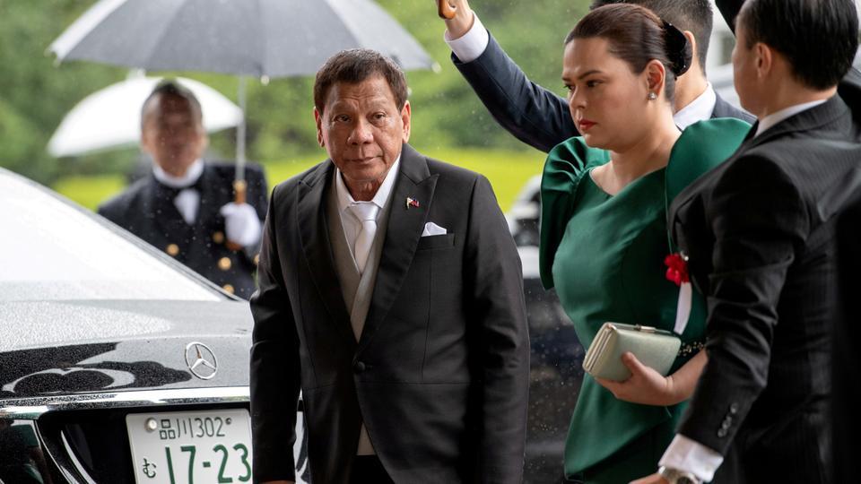 FILE PHOTO: Philippines President Rodrigo Duterte arrives with daughter Sara Duterte-Carpio to attend the enthronement ceremony of Japan's Emperor Naruhito in Tokyo, Japan October 22, 2019.
