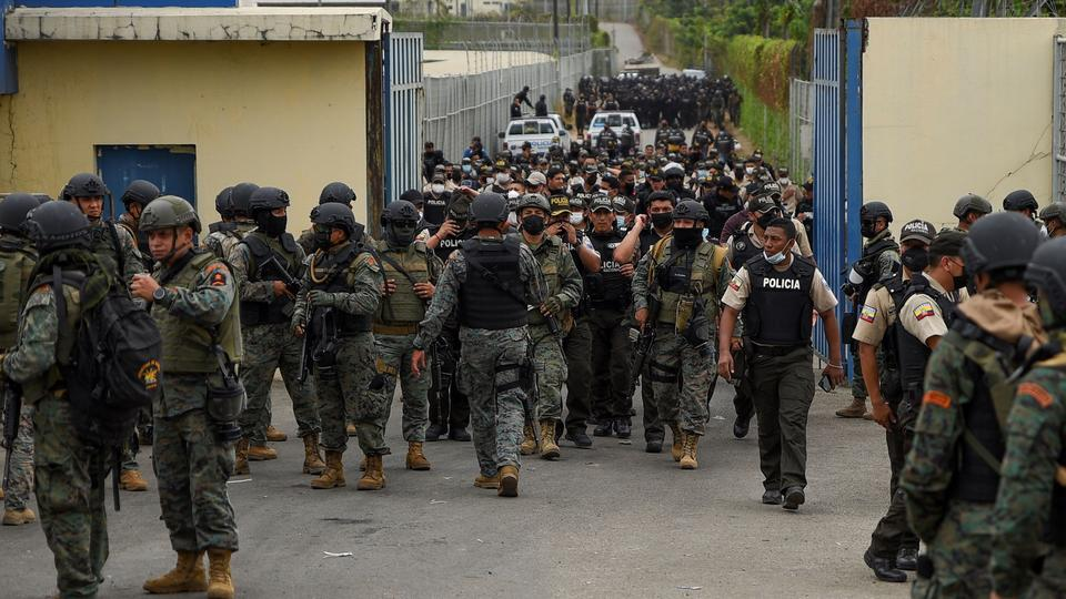 Police walk out the Regional de Guayaquil prison after unrest was reported since the country's worst-ever riots broke out a few days ago at the Penitenciaria del Litoral, in Guayaquil, Ecuador October 2, 2021.