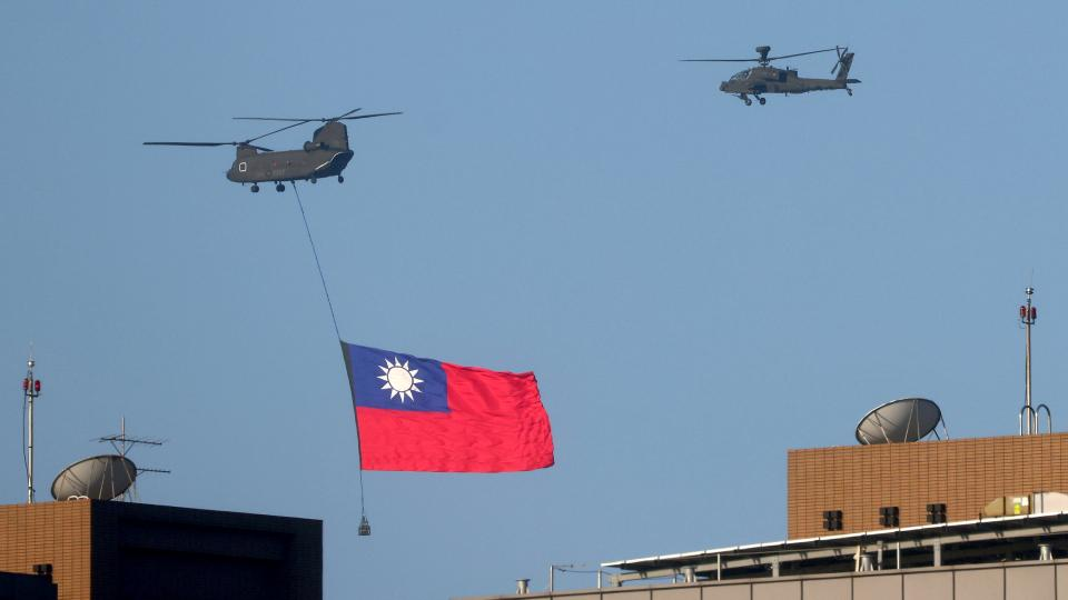 A Taiwan flag is carried across the sky during a national day rehearsal in Taipei, on Taiwan, October 5, 2021.