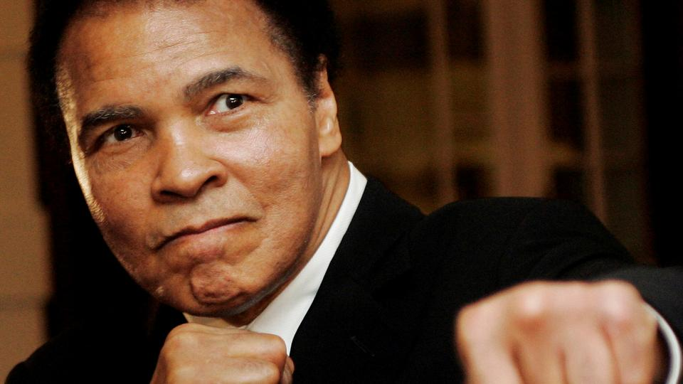 Muhammad Ali poses during the Crystal Award ceremony at the World Economic Forum (WEF) in Davos, Switzerland, in this January 28, 2006 photo.