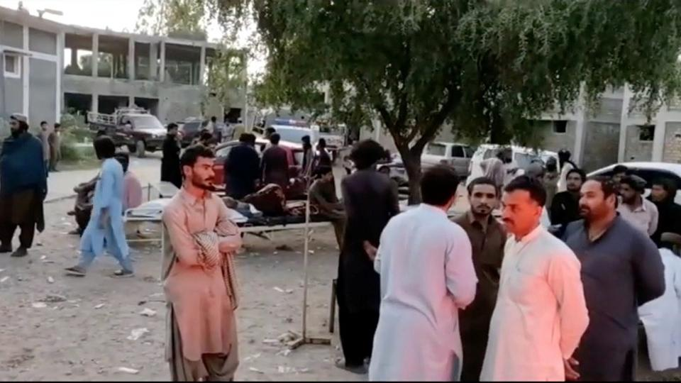 People gather outside a hospital following an earthquake in Harnai, Balochistan, Pakistan, October 7, 2021, in this still image obtained from video. (Courtesy of QuettaVoice.com)