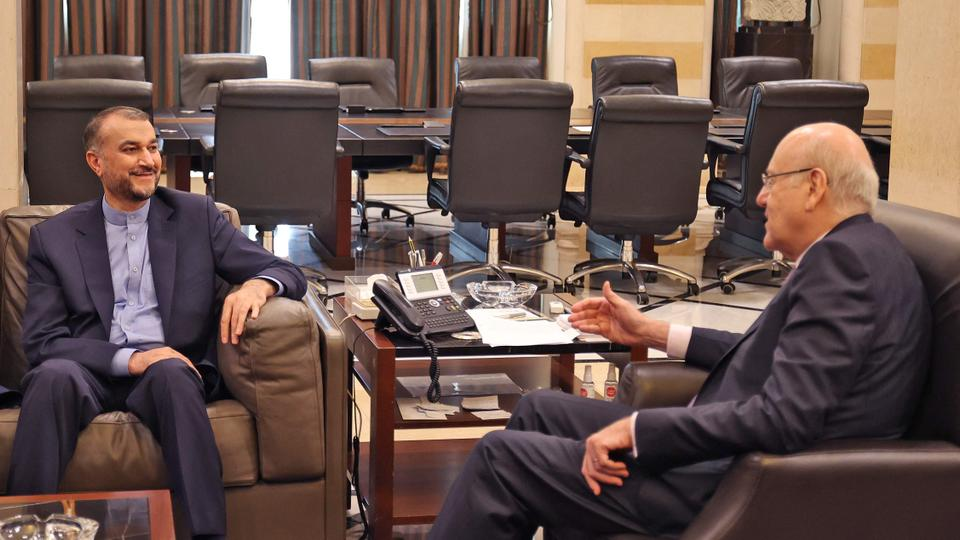 Lebanon Prime Minister Najib Mikati (R) and Iran's Foreign Minister Hossein Amir-Abdollahian meet in Beirut on October 7, 2021.